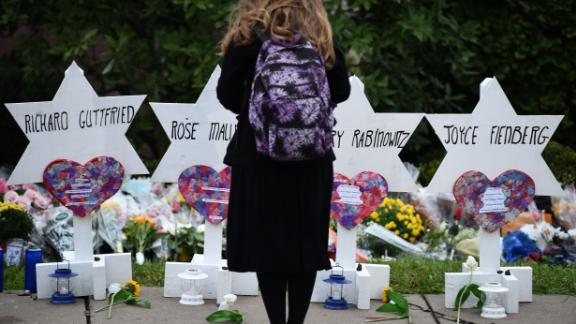 "TOPSHOT - A woman stands at a memorial outside the Tree of Life synagogue after a shooting there left 11 people dead in the Squirrel Hill neighborhood of Pittsburgh on October 27. - Mourners held an emotional vigil Sunday for victims of a fatal shooting at a Pittsburgh synagogue, an assault that saw a gunman who said he ""wanted all Jews to die"" open fire on a mostly elderly group. Americans had earlier learned the identities of the 11 people killed in the brutal assault at the Tree of Life synagogue, including 97-year-old Rose Mallinger and couple Sylvan and Bernice Simon, both in their 80s.Nine of the victims were 65 or older."