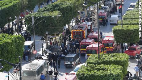 Police and firemen respond after a suicide attack in the Tunisian capital, Tunis.