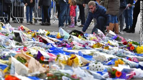 Flowers are piled up outside the King Power Stadium in Leicester following the death of the club's owner in a helicopter crash.