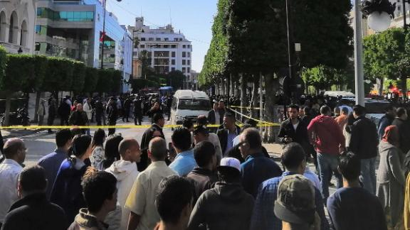 Crowds gather near the site of an explosion in the center of Tunis.
