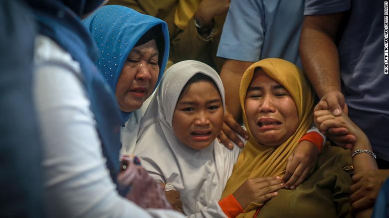 Family members of the crashed Indonesian Lion Air JT-610 react at Pangkal Pinang airport, in Bangka Belitung province on Oct. 29, 2018.