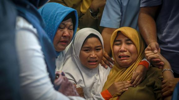 Family members of the crashed Indonesian Lion Air JT-610 react at Pangkal Pinang airport, in Bangka Belitung province on October 29, 2018. - An Indonesian Lion Air plane carrying 188 passengers and crew crashed into the sea on October 29, 2018, officials said, moments after it had asked to be allowed to return to Jakarta. (Photo by HADI SUTRISNO / AFP)        (Photo credit should read HADI SUTRISNO/AFP/Getty Images)