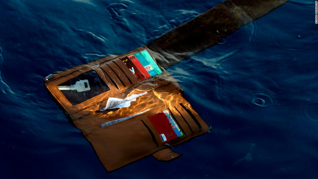 A wallet is seen in the water where the plane went down.