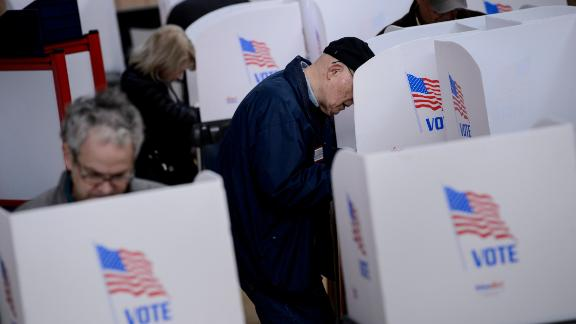 People cast their ballots during early voting at a community center October 25, 2018 in Potomac, Maryland, two weeks ahead of the key US midterm polls. (Photo by Brendan Smialowski / AFP)        (Photo credit should read BRENDAN SMIALOWSKI/AFP/Getty Images)