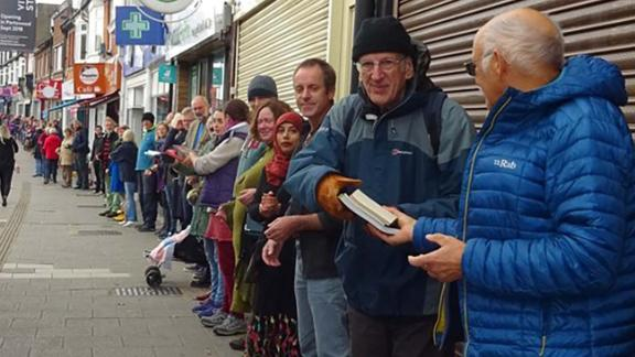 People form human chain to help community bookshop move books