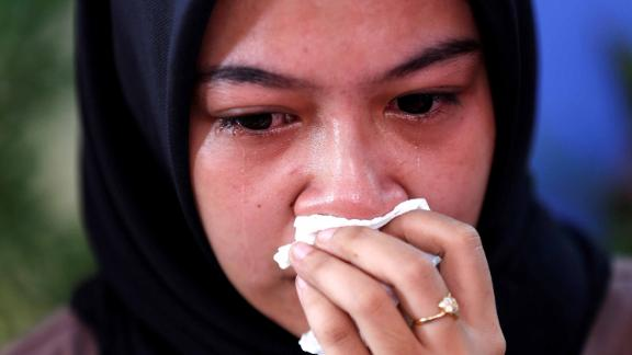 A relative of a passenger cries at a hospital in Jakarta.
