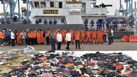 Indonesia's President Joko Widodo tours the operations centre as recovered debris from the ill-fated Lion Air flight JT 610 are laid out at a port in northern Jakarta.