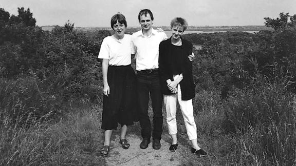 Merkel poses with her siblings, Marcus and Irene Kasner.