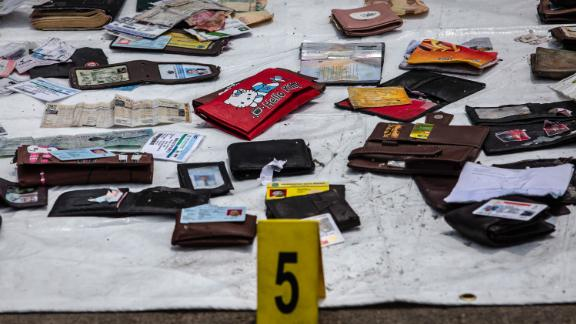 Personal items from Lion Air flight 610 seen as Search and Rescue personnel examine recovered material at the Tanjung Priok port on October 30, 2018 in Jakarta, Indonesia.