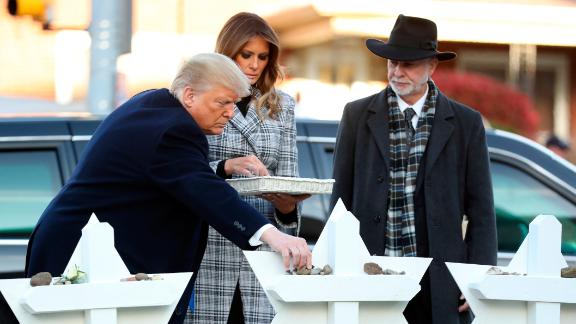 The President and first lady put down stones from the White House and flowers at a memorial for those killed in the massacre.