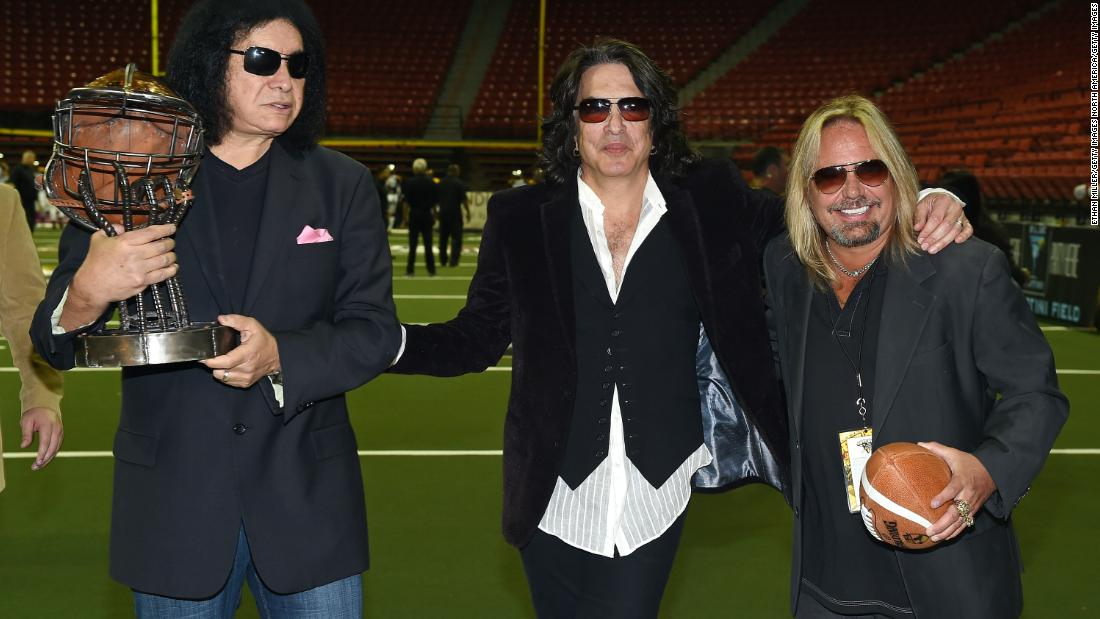 "Owners of the Los Angeles Kiss, Gene Simmons (left) and Paul Stanley (middle), pose alongside Motley Crue singer Vince Neil, owner of the Las Vegas Outlaws, before squaring off in Las Vegas on May 4, 2015. The TV series ""4th and Loud"" depicted the travails of football ownership during the Kiss's first season."