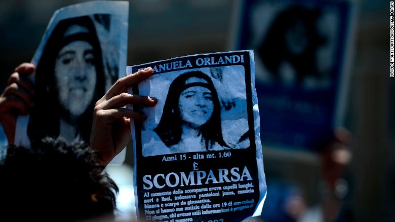 "A demonstrator holds a poster of Emanuela Orlandi reading ""Missing"" during Pope Benedict XVI's Regina Coeli noon prayer in St. Peter's square, at the Vatican on May 27, 2012."