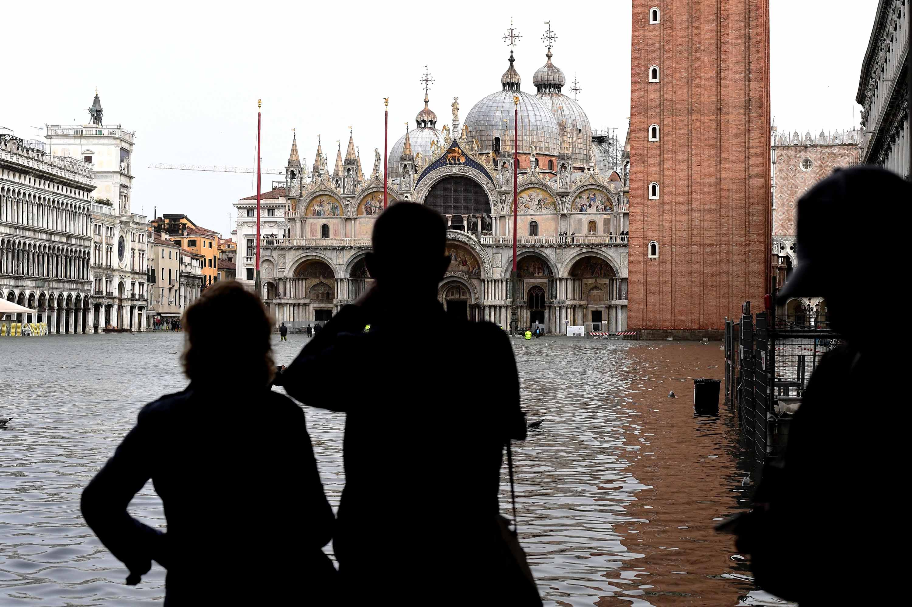italy storms leave several dead, venice flooded - cnn video