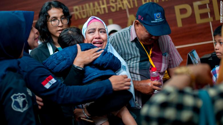 A woman related to a passenger of Lion Air Flight JT 610 cries at a hospital in Jakarta, Indonesia, on Tuesday, October 30. Family members have been providing authorities with DNA samples to help identify victims of the crash.