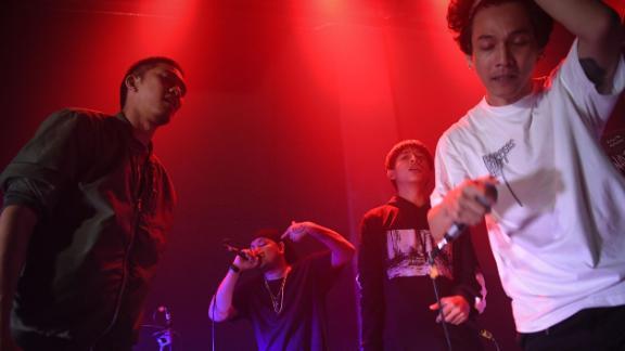 "Members of the group Rap Against Dictatorship perform ""Prathet Ku Mee"" on stage in Bangkok on Oct. 27, 2018."