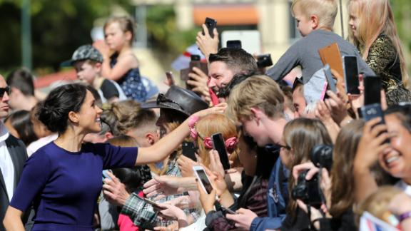 Meghan, Duchess of Sussex shakes the hand of a young boy during a public walkabout at the Rotorua Government Gardens.