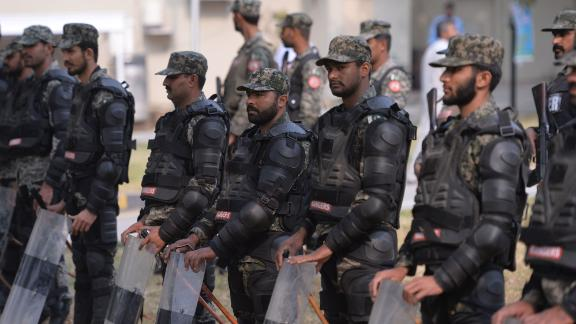 Pakistani paramilitary soldiers stand guard outside the Supreme Court building in Islamabad on October 31.