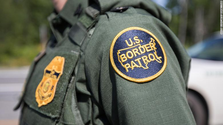 a patch on the uniform of a us border patrol agent at a highway checkpoint on