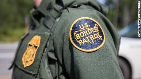 A U.S. Border Patrol agent stands at a highway checkpoint in Maine