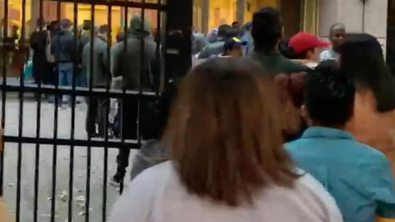 In this screengrab from a handout video provided by the American Immigration Lawyers Association, people are seen lining up outside the Atlanta Immigration Court on October 31.