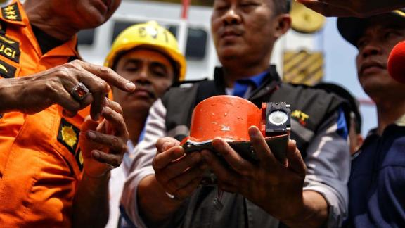 """A photo from Indonesian media agency """"detikcom"""" shows officials displaying part of the ill-fated Lion Air flight JT 610"""