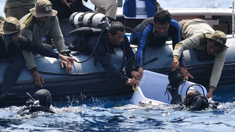 Indonesian Navy divers recover a flight data recorder on Thursday, November 1, from the underwater wreckage of Lion Air flight JT 610 in the Java Sea, north of Karawang, Indonesia.