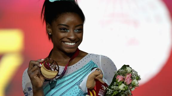 Despite falling in her vault, falling in her balance beam routine and stepping out of bounds on the floor exercise, Simone Biles won her fourth world championships all-around title.