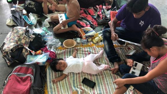 A baby sleeps among thousands of migrants at the old bus station in Juchitán, Mexico, which local volunteers prepared to house the migrant caravan.