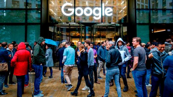 Google staff stage a walkout at the company's UK headquarters in London on November 1, 2018 as part of a global campaign over the US tech giant's handling of sexual harassment.