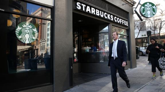 A pedestrian walks by a Starbucks Coffee shop. (Photo by Justin Sullivan/Getty Images)