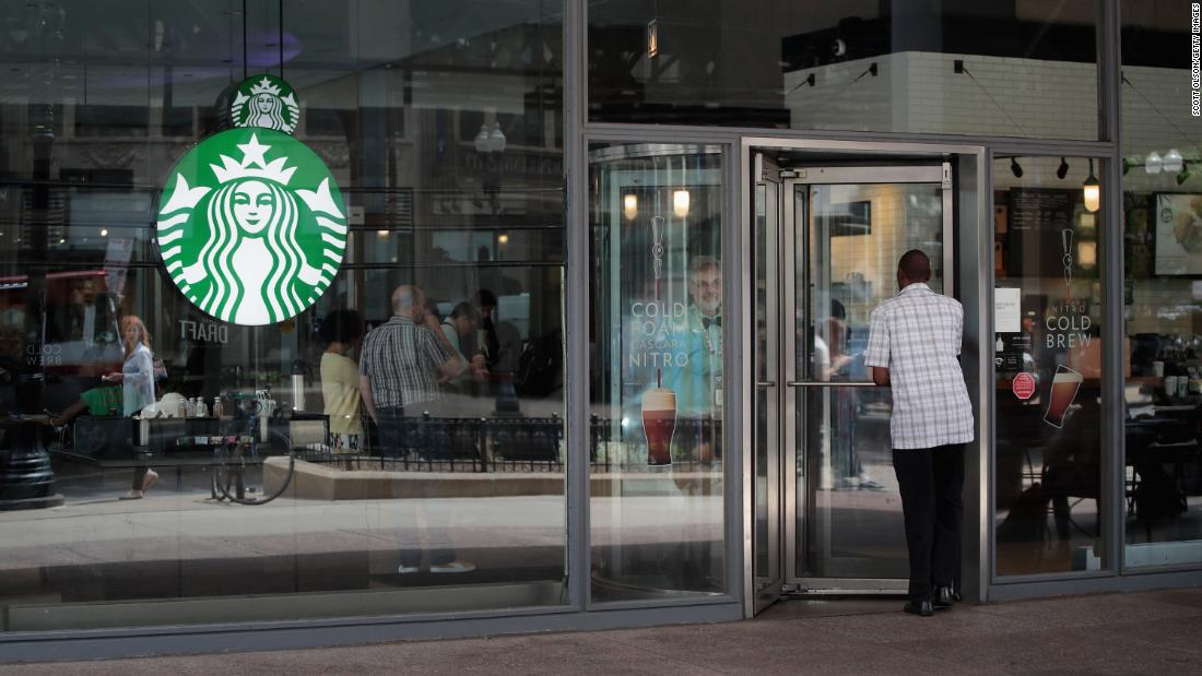 Ex-Starbucks official sues over his firing after the arrests of two black men