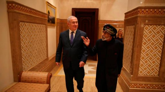 Benjamin Netanyahu strolls with Sultan Qaboos bin Said in Oman, in a photo posted on Twitter by the Israeli PM's office.