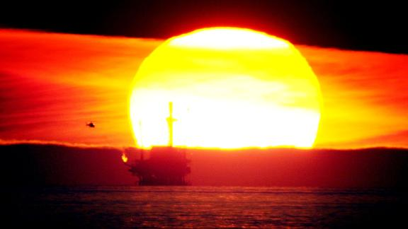 The sun sets behind the Hillhouse A oil and gas platform near the Federal Ecological Reserve in the Santa Barbara Channel, February 15, 2001, near Santa Barbara, CA.