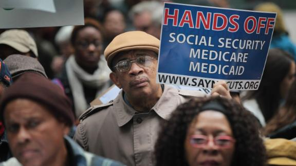 CHICAGO, IL - NOVEMBER 07:  Demonstrators, including many senior citizens, protest against cuts to federal safety net programs, including Social Security, Medicare, and Medicaid on November 7, 2011 in Chicago, Illinois. About 40 of the demonstrators were arrested, cited, and released after they blocked a downtown intersection and refused police orders to move.  (Photo by Scott Olson/Getty Images)