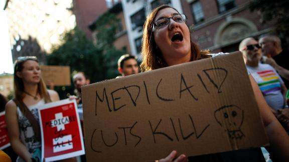 NEW YORK, NY - JULY 5: A small group of activists rally against the GOP health care plan outside of the Metropolitan Republican Club, July 5, 2017 in New York City. Republicans in the Senate will resume work on the bill next week when Congress returns to Washington after a holiday recess. (Photo by Drew Angerer/Getty Images)
