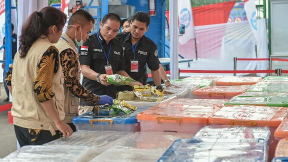 Indonesian authorities display packs of methamphetamine before destroying them in this photo taken on May 4.