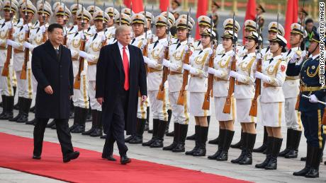 China's Jin Jinping (L) President and US President Donald Trump China's Honorary Officials in Beijing on November 9, 2017