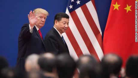 TOPSHOT - US President Donald Trump (L) and China's President Xi Jinping leave a business leaders event at the Great Hall of the People in Beijing on November 9, 2017.
