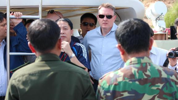 Jeremy Douglas of the UNODC (center) is seen on a Chinese patrol boat on the Mekong River between Myanmar and Laos in 2016.