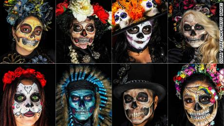 Participants prepare to celebrate the Day of the Dead in Mexico City on October 21, 2018