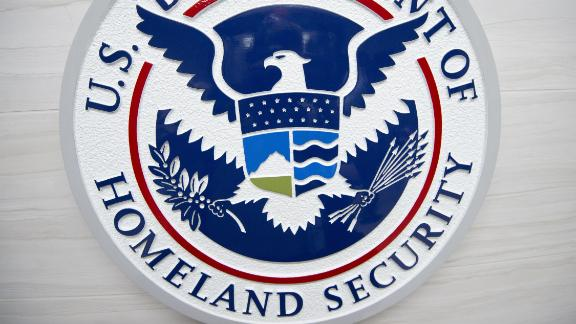 The Department of Homeland Security logo is seen at the new ICE Cyber Crimes Center expanded facilities in Fairfax, Virginia July 22, 2015. The forensic lab combats cybercrime cases involving underground online marketplaces, child exploitation, intellectual property theft and other computer and online crimes.  AFP HOTO/Paul J. Richards        (Photo credit should read PAUL J. RICHARDS/AFP/Getty Images)