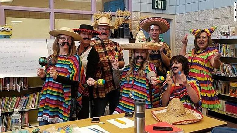 Another now-deleted picture from the school's Facebook page showed staff members dressed in sombreros with maracas.