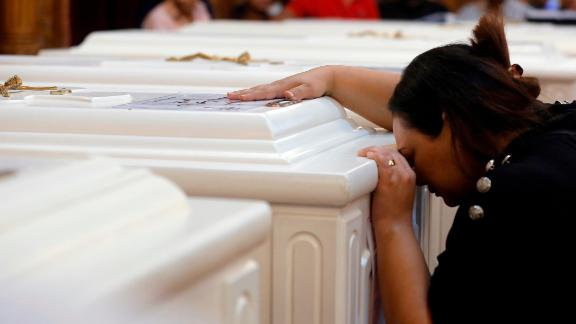 A relative grieves during the funeral service Saturday in Minya.