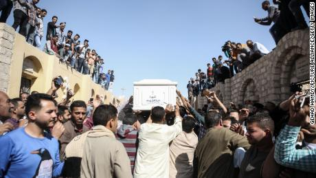Mourners carry a coffin at a funeral service Saturday in the Egyptian city of Minya.