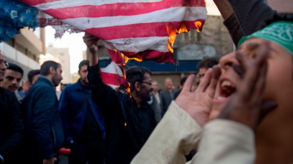 TEHRAN, IRAN - NOVEMBER 4: On the eve of renewed sanctions by Washington, Iranian protesters demonstate outside the former US embassy,  marking the anniversary of its storming by student protesters that triggered a hostage crisis in 1979 on November 4, 2018 in Tehran, Iran. Today marked the 39th anniversary of the hostage crisis at the former U.S. embassy in Tehran, and tomorrow sees the U.S., after withdrawing from the Joint Comprehensive Plan of Action (JCPOA), impose fresh sanctions on the country. (Photo by Majid Saeedi/Getty Images)