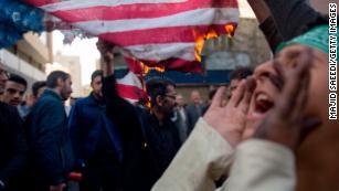 Tough talk, despair divide Tehran's streets as sanctions strike