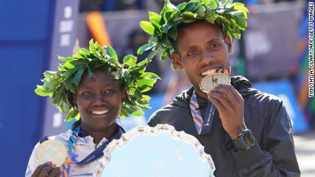 Winners Mary Keitany of Kenya, left, and Lelisa Desisa of Ethiopia pose with their medals during the 2018 TCS New York City Marathon in New York on November 4, 2018.