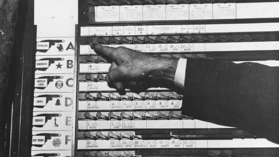 Circa 1950, mechanical voting machines took the place of paper ballots for elections in New York.
