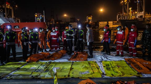 Body bags are laid out at Jakarta's Tanjung Priok port on November 3.