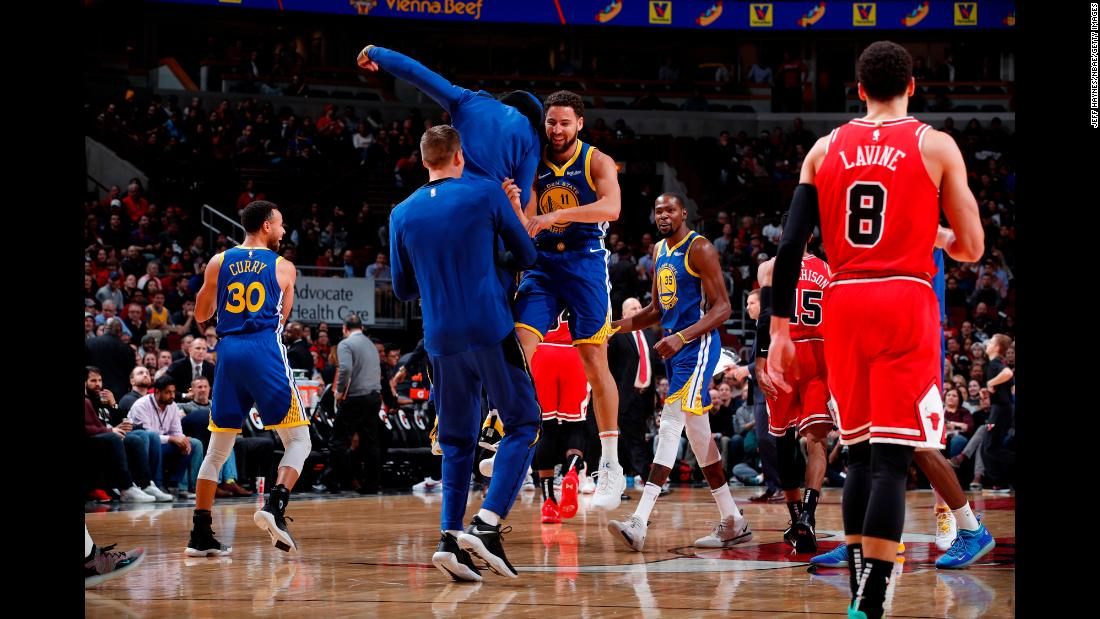 Golden State Warriors guard Klay Thompson celebrates during a game against the Chicago Bulls after breaking the NBA record for most 3-pointers in a game -- 14. His teammate, Stephen Curry, held the record before him.